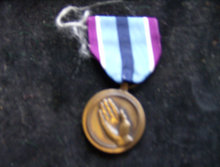 THE HUMANITARIAN SERVICE MEDAL