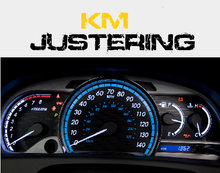 km justering